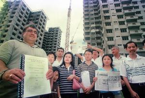 Help Us: Buyers for the low-cost housing project in Taman Setapak Jaya Baru claiming Kuala Lumpur City Hall (DBKL) and developer Pancaran Nilai Sdn Bhd had failed to complete the project since 1999 - Bernama picture